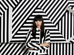 Inspiration for a window display using black and white stripe and red lips on mannequin.