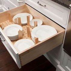 Kitchen Storage - nice way to organize and store dishes. And no pulling out to get to the dishes at the back of the cupboard.