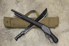 Lever action shotgun, machete and scabbard combo.