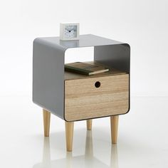 JIMI wood and metal bedside table: Check out a new twist on the retro look with this bedside table in wood and painted metal. This will look great in your bedroom and is super practical with a drawer and storage compartment. Description of JIMI bedside table:1 drawer1 compartmentFeatures of JIMI bedside table:Solid birch legs with nitrocellulose finishAsh veneered MDF drawer with nitrocellulose finishPainted metal with epoxy finishSee the full JIMI collection available online at laredoute...