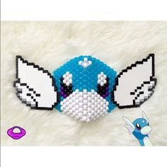 Kandi Dratini Mask Pokemom Character Rave   EDM  EDC  RAVE  KANDI  Draino I spired 3D Kandi Mask Glow in the Dark Pokemon Inspired Surgical Kandi Mask Water Dragon Pokemon Rave Hear EDM Wear Custom Kandi  ✨ Cheaper shipping & 20% off only on Planetplur.etsy.com ✨  ❌NO TRADES, NO EXCEPTIONS❌  This is a custom handmade piece by Brittany Rey. Colors and size can be changed. Comment if you have any questions!   Follow for more coupons: IG: @PlanetPlurOfficial Facebook: Facebook.com/PlanetPlur…