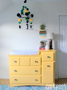 Yellow Changing Table with Pineapple Decor - such a fun and funky nursery!