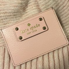 Kate Spade card holder Kate Spade graham in ballet slip pink (pale pink color) part of wellesly collection. Has 3 card slots along with opening for cash.  Used in clutches a few times. Selling because I bought a new one to use. Very sturdy leather with late Spade logo on each side. Comes from a smoke free home. Accepting reasonable offers. kate spade Accessories Key & Card Holders