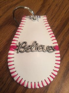 Pink Believe baseball keychain