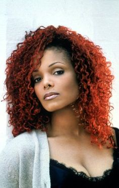 Red curly hair, septum piercing..Janet Jackson