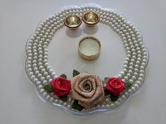 Indian Traditional Pooja/Aarti Thali Handemade using acrylic plate with Ribbon and Bead work. Contains one candle holder and Haldi-Kumkum Holders as well. Two designs available. Diameter- approximately Thali Decoration Ideas, Diwali Decorations, Kalash Decoration, Diya Designs, Diwali Rangoli, Diwali Gifts, Plate Design, How To Make Beads, Diy Wedding