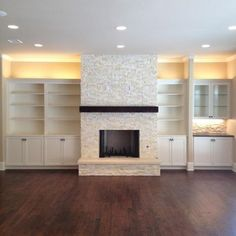 pretty, light colored stone with white bookshelves