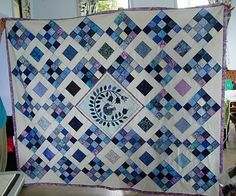 Love this basic design - I would actually stick to the 2 base blocks. from The Slightly Mad Quilt Lady: Blue and white with a touch of madness