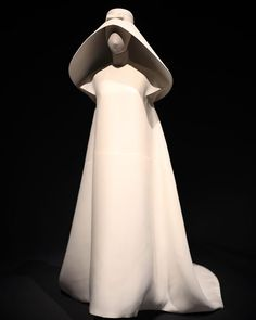 Single-seam wedding dress by Cristóbal Balenciaga, 1967. The headpiece's shape and volume were inspired by the hats used by Spanish fishermen and designed to replace the traditional bridal lace veil. Full story on Facebook/Balenciaga. #Balenciaga #BalenciagaArchives #Inspiration