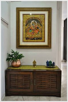 Sophisticated Simplicity : A collection of semi precious stone Ganesha Statutes, an antique brass Kamakshi lamp and an exquisite Tanjore painting of Radha and Krishna Indian Home Interior, Indian Interiors, Ethnic Home Decor, Indian Home Decor, Apartment Therapy, Indian Inspired Decor, India Decor, Pooja Room Design, Tanjore Painting