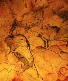 Altamira Cave. The ceiling art does not conform to any alignment or proportion of size, and some images overlap others.