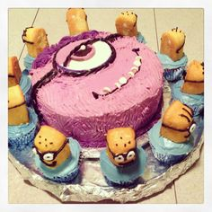 Purple Minion cake with yellow minions per my daughters request for her bday.