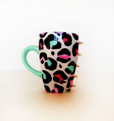 Meow – Coffee mug – tiffany blue handle – colorful leopard featuring gold spikes ©