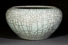 A Chinese Ge Ware Porcelain Alms Bowl, probably c., tapering globular body with incurved rim covered overall in an even celadon glaze with gold and black crackle, height 6 in., diameter 12 in Traditional Chinese, Chinese Style, Sea Silk, Chinese Bowls, Manga Artist, Chinese Ceramics, Light And Shadow, Chinoiserie, Accent Pieces