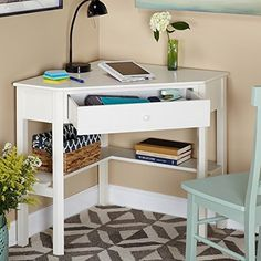 This classically styled desk utilizes a small space for a big impact, with stylish under-desk shelving and a drawer to hide clutter. Simple Living Wood Corner Computer Desk (Antique White) Best Offer ReviewDimensions: 42W x 28D x 30H in.Corner-molded desk.