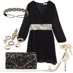 Il vestito nero ha un modello ampio che stringe in vita con una cintura di  paillettes 1e88fef576a