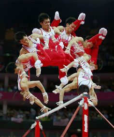 Kazuhito Tanaka of Japan competes on the horizontal bar during the men's gymnastics team final in the North Greenwich Arena on Monday. This picture was taken using multiple exposures.