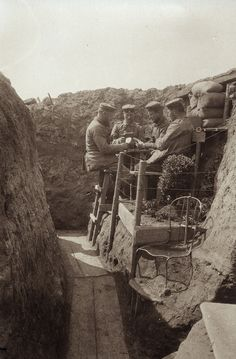 German soldiers playing cards by the garden in their WW1 trenches