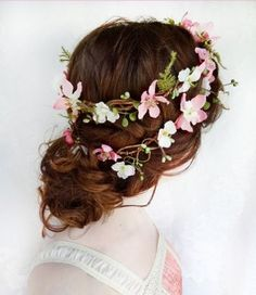 Graceful Updo Hairstyle with Flower Crown - partly braided hair with flowers over bun