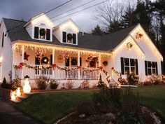 Stunning Outdoor Christmas Displays An Abundance of Wreaths—Each window on this Massachusetts home is covered by simple green wreaths for a classic Christmas look.