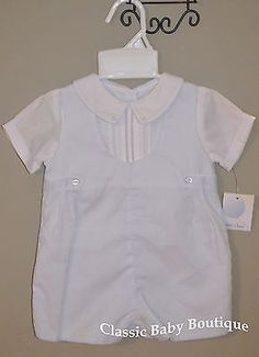 Handsome shortall with white faux undershirt with pintucks and fagotting, white peter pan collar with blue dot embroidery, side tabs. Buttons down the back, snaps at the straddle. Poly/cotton blend.