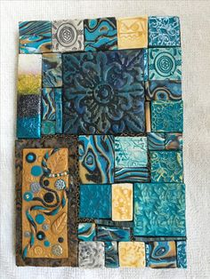 Turquoise and Gold Mosaic Tiles This unique turquoise and gold mosaic tile design was originally on the cover of a journal and consisted of one of a kind polymer clay tiles that were created using various polymer clay techniques. Ceramic Wall Art, Tile Art, Mosaic Art, Mosaic Tiles, Ceramic Pottery, Mosaic Tile Designs, Clay Tiles, Paperclay, Sculpture Clay