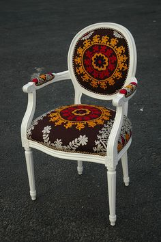 Suzani print on a white lacquered chair. again vintage furniture in Dallas TX.