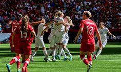 England celebrate Lucy Bronze's goal.