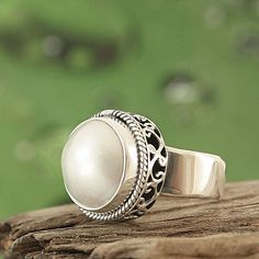 Add a classic pearl accent to your wardrobe with this beautiful Bali ring. Handmade ring features a rope edged round white mabe pearl in an antiqued sterling silver setting.