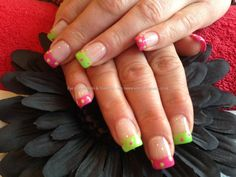 Acrylic nails with lime green and pink polka dot nail art