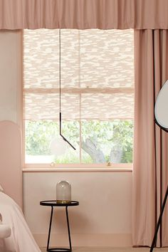 2LG Studio picked out a semi-sheer textured Roller blind in Motto Powder Blush to fill the room with diffused natural light and layered Tetbury Blush curtains over the blinds to frame and elongate the windows #ILOVETHATSTYLE