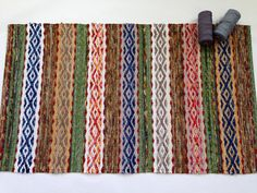 "RESERVED FOR CHARITY Swedish Rosepath Rag Rug 25 x 42 inches / 63.5 x 106.5 cm : Completely reversible, each side subtly different : Contrasting woven hems, machine-stitched for durability : Tightly woven selvedges ""Best Kind of Music"" Rag Rug is an expression of the vibrant elements of interesting music, including rhythm, melody, balance, harmony, and surprise. Bringing meaningful beauty to your home. With rich colors and sophisticated design, this one-of-a-kind handwoven..."