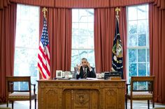 President Barack Obama taking a call from the Oval Office on September 28, 2012.