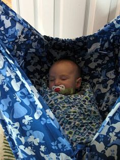 "for @Betsy Finn -- the baby hammock instructions i (roughly) followed. i didn't have enough length in the fabric I wanted so i tied it to sling rings which hang from the wooden spreader bar. for a larger baby i might look at 60"" wide fabric? I'm still debating what to do with Hazel next as she *loves* her hammock, but is getting a bit big for it."