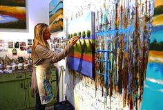Tjasa Owen working in her San Francisco studio. www.tjasaowen.com www.tjasaowen.blogspot.com A wonderful photographer Beppe Sabatini took this photo of Tjasa Owen in her studio the other day working on a landscape. Here is his link to more of his work... http://www.flickr.com/phot…/8703833@N08/…/72157633608989882/