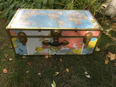 Large and Colorful world map trunk with locking key. This trunk has been loving decoupaged on all sides. The maps have been carefully cut around the edging and latches. The edging has patina and is rusty in spots, giving it beautiful character and charm. Yet, all hinges and latches still work beautifully. The handle is in great shape and allows you to carry the trunk wherever it needs to go. Includes a world map on the top, Europe on the front, and several colorful world maps on the sides…