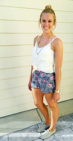 The floral shorts and the simple top and  shoes are so cute together. Very simple, yet fashionable.