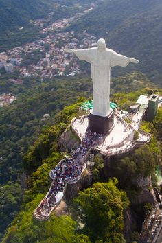 One of Brazil's most iconic symbols, the Art Deco styled statue of Jesus Christ in Rio de Janeiro is one of the seven wonders of the world. The credit of building the statue goes to Paul Landowski, a French sculptor. Christ The Redeemer Brazil, Christ The Redeemer Statue, Jesus Christ, Machu Picchu, Cristo Corcovado, Places To Travel, Places To Visit, Visit Brazil, Great Wall Of China
