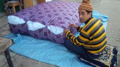 the colors, the patterns, and the act of making a mattress on the street, all of the things we love to come across