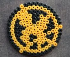mocking jay from hunger games made out of perler beads