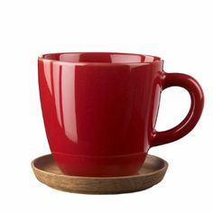 Hoganas Apple Red Glossy Coffee Mug: This mug by Hoganas is made from Swedish stoneware of best quality with a practical and stylish wooden coaster which can also be used as a lid.