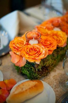 I absolutely adored my centerpieces. I did half like this down the middle of the oval table and the other half of the tables with 3 square vases filled with these type of roses or circius roses (dark orange transitioning to yellow).  Photo by Alexis Stein Photography of Long Island   www.alexissteinphoto.com  centerpiece:  http://www.rootsflowersandtreasures.net/