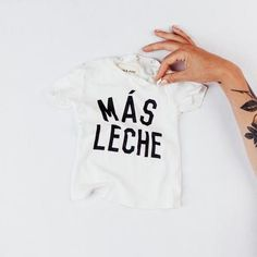Super cute onesie that says more milk in Spanish! Organic cotton, LA made, enzyme washed & hand printed. **May run slightly big**