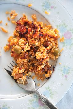 Arroz con Gandules (Rice and Pigeon Peas): Sofrito, smoky bacon, olives, and capers form a flavorful base for a side of rice mixed with nutty pigeon peas—perfect with pasteles!