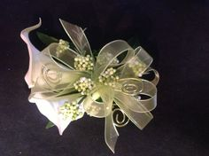 Prom Flowers Green wire twirls add excitement to this Calla Lily wrist corsage.