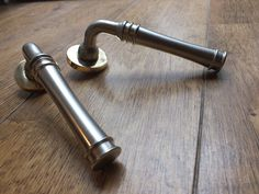 "Beautiful and stunningly elegant ""Impulse"" door handles, available from British Ironmongery. These British made, hand-finished handles are displayed here in a split finish - pearl nickel levers mounted on a polished brass rose. See them on the British Ironmongery website at - http://www.britishironmongery.co.uk/shop/impulse-lever-on-covered-rose-door-handle/1486.htm"