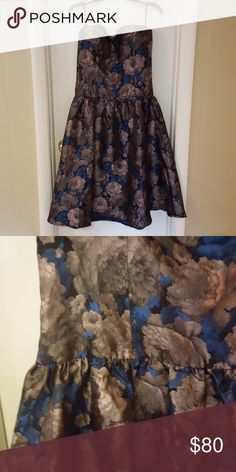Navy printed strapless dress Size 14. Print is navy with lavender and brown flowers. Strapless, but detachable straps included. Chi Chi London Dresses Strapless