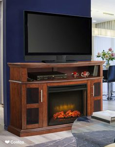 """The Rochester media fireplace combines functionality with fine furniture styling. With it's distinctive design it accommodates TV's up to 60"""" as well as DVD players and other media components. The swing out side cabinets also provide ample storage and easy access."""