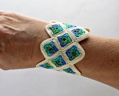 Crochet Bracelet Cuff Miniature Granny Square in Ecru Green Blue    The creativity and artistry Emily of Nothingbutstring is lovely, and her color choices.