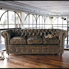 I am in love with this vintage leather sofa